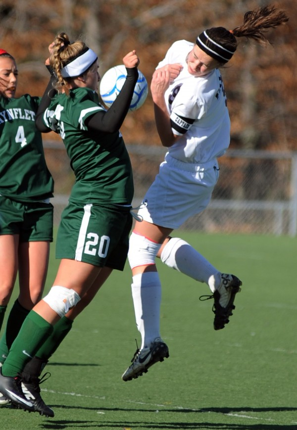 Waynflete's Cat Johnson and Orono's Hanna Renedo go up for a header during the girls Class C State Championship game on Saturday in Hampden.  Waynflete won the game 3-2 in double overtime.
