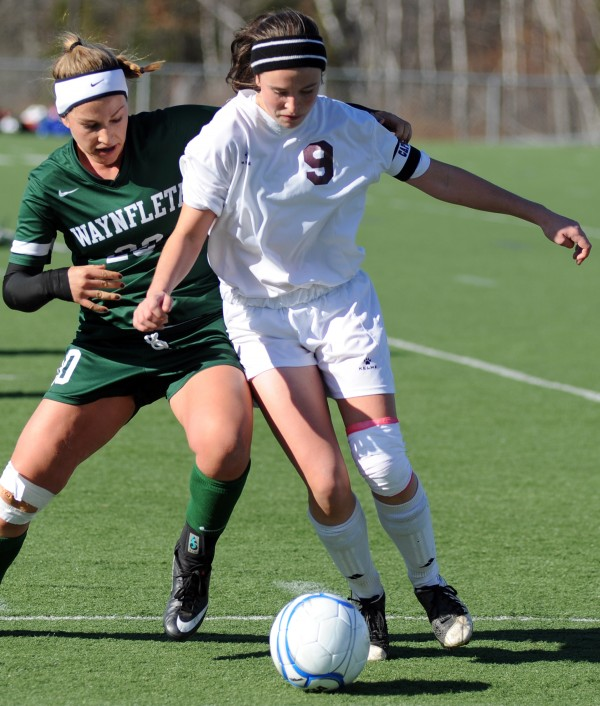 Orono's Hanna Renedo tries to keep control of the ball from Waynflete's Cat Johnson in the girls Class C State Championship game on Saturday in Hampden.  Waynflete won the game 3-2 in double overtime.