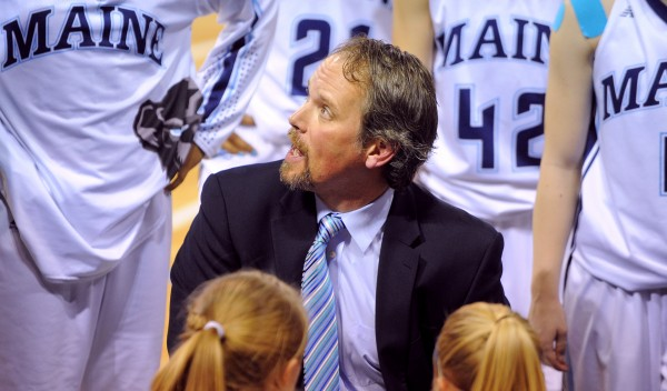 The University of Maine woman's basketball head coach Richard Barron talks to the players during  the game against Green Bay at the Cross Insurance Center in Bangor on Saturday.
