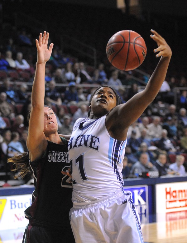 The University of Maine's Sheraton Jones (right) takes a rebound over Green Bay's Tesha Buck during the game at the Cross Insurance Center in Bangor on Saturday.