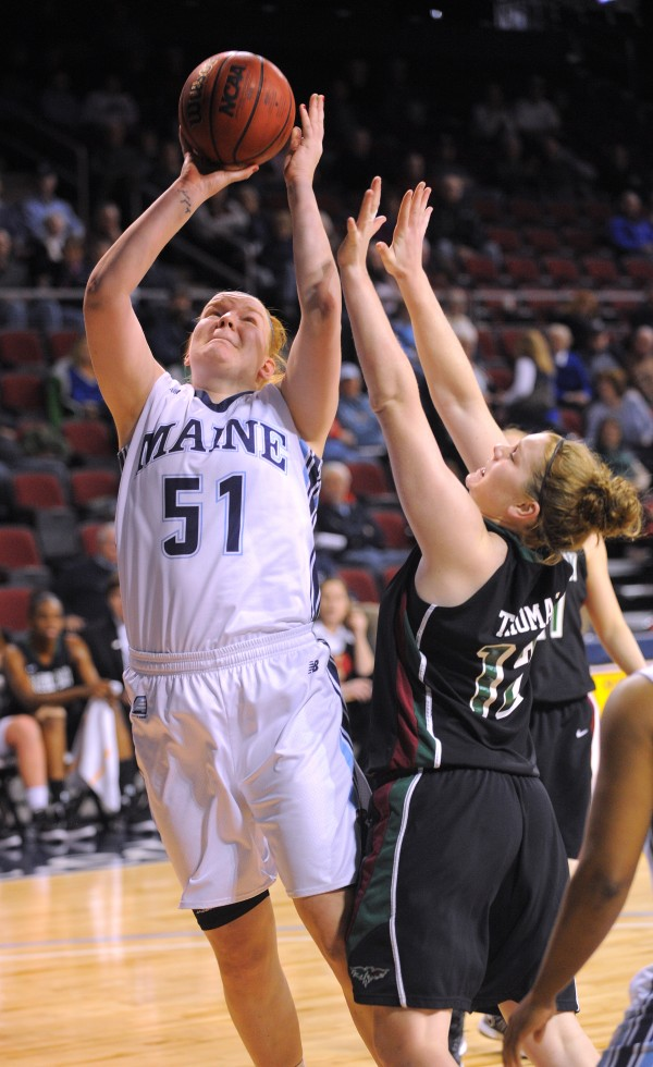 The University of Maine's Anna Heise (left) goes up for a shot over Green Bay's Taylor Thomas during the game at the Cross Insurance Center in Bangor on Saturday.