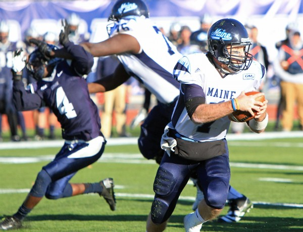 University of Maine's Tyler Patterson blocks University of New Hampshire's Manny Asam for quarterback Marcus Wasilewski during Saturday's game at Cowell Stadium in Durham.