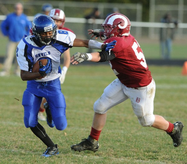 Lewiston's Ben Howell shakes a tackle attempt by Bangor's Adam Allen during third-quarter action Saturday at Bangor.