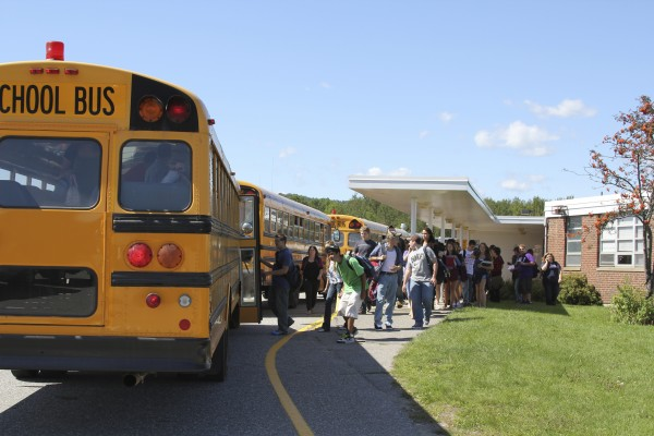 Students from Oceanside High School in Rockland load on to buses after the first day of school in 2011.