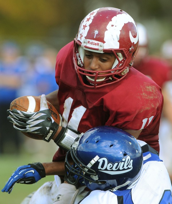 Bangor's Xavier Lewis snags a pass intended for Lewiston's Ben Howell during third-quarter action Saturday at Bangor.