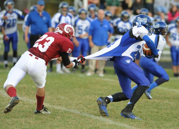 Lewiston's Sheon James is reeled in by Bangor's Aly Elfaham during second-quarter action Saturday at Bangor.