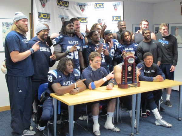 The senior members of the University of Maine football team pose with the Colonial Athletic Association championship trophy during the press conference after Saturday's 41-0 victory over Rhode Island at Alfond Stadium in Orono. The sixth-ranked Black Bears have earned a spot in the Football Championship Subdivision playoffs.