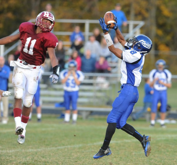 Lewiston's Ben Howell makes a catch as Bangor's Xavier Lewis watches during second-quarter action Saturday at Bangor. Bangor beat Lewiston 55-21