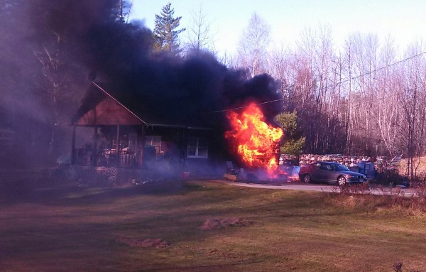 A structure fire rages at 428 Bangor Road in Ellsworth on Nov. 20, 2013.