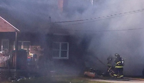 Crews attempt to put out the fire at 428 Bangor Road in Ellsworth on Nov. 20, 2013.