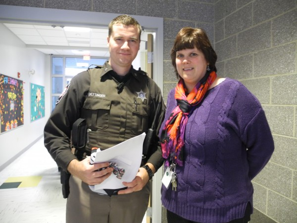 Deputy Nick Oettinger of the Waldo County Sheriff's Office and Mount View High School alternative education teacher Patty Armstrong after a Thursday school assembly about the dangers of texting while driving. Armstrong's 20-year-old daughter was killed by a texting driver four years ago while she was studying abroad in Austria.
