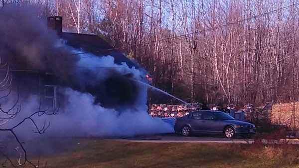 Crews battle the blaze at 428 Bangor Road in Ellsworth on Nov. 20, 2013.