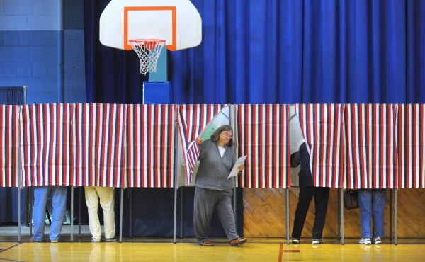 Voters turn out at the Brewer Auditorium on Tuesday morning in Brewer to cast their votes.