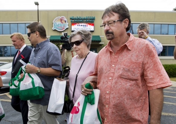 Gloria C. Mackenzie, an 84-year-old woman from Zephyrhills, Florida (center) and her son Scott (right) leave the Florida Lottery offices after claiming the largest single jackpot in American lottery history, valued at $590 million, in Tallahassee, June 5, 2013.