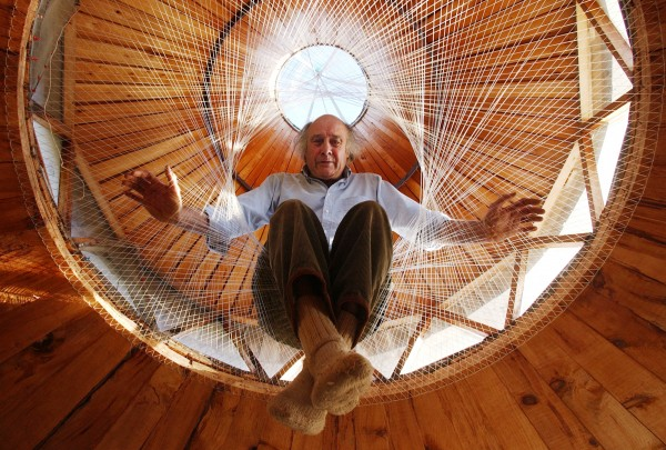 William Coperthwaite, author of &quotThe Handmade Life: In Search of Simplicity,&quot  sits suspended by 100-pound fishing line that he has incorporated into the design of his yurt in Machiasport in 2003.