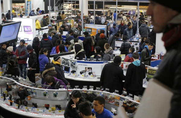 Customers shop at the Best Buy store, which opened at 1am, in Cambridge, Massachusetts November 29, 2013. Black Friday, the day following the Thanksgiving Day holiday, has traditionally been the busiest shopping day in the United States.