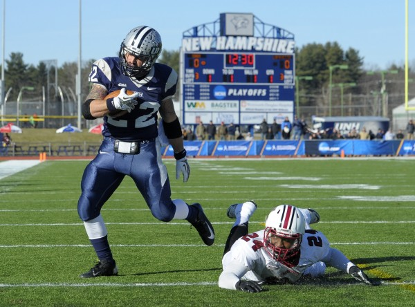 New Hampshire Wildcats running back Nico Steriti (22) scores a touchdown during the first half of Saturday's NCAA playoff game against the Lafayette Leopards at Cowell Stadium in Durham, N.H.