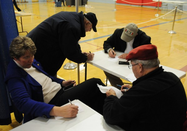 Beverly Uhlenhake, William T. Rogers and Kevin J. M. O'Connell take notes as Larry Doughty reads the totals after the polls closed at the Brewer Auditorium on Tuesday night. Beverly Uhlenhake and Kevin J.M. O'Connell were elected to seats on the Brewer City Council.