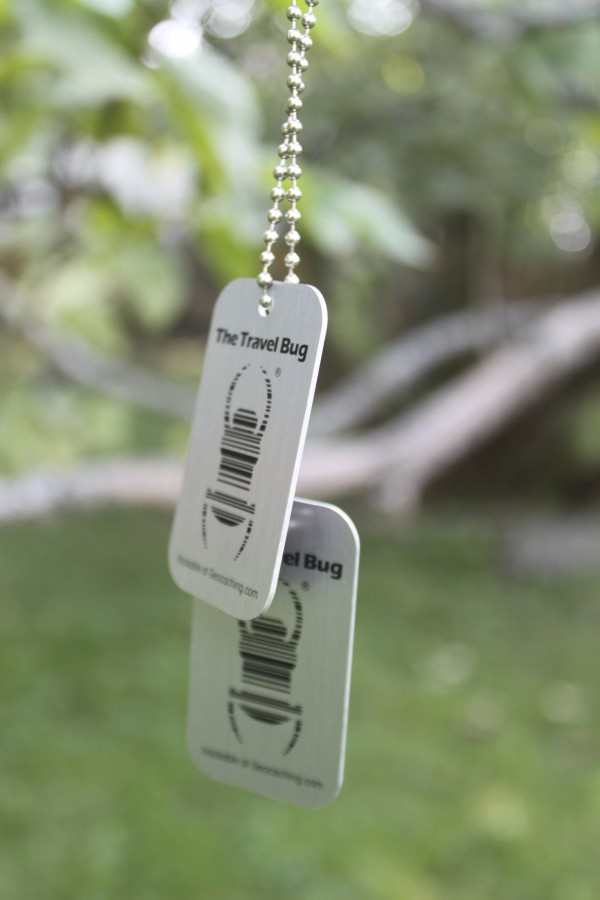 Travel bugs are trackable metal tags that can be attached to objects so they can be tracked on geocaching.com as they move from geocache to geocache.