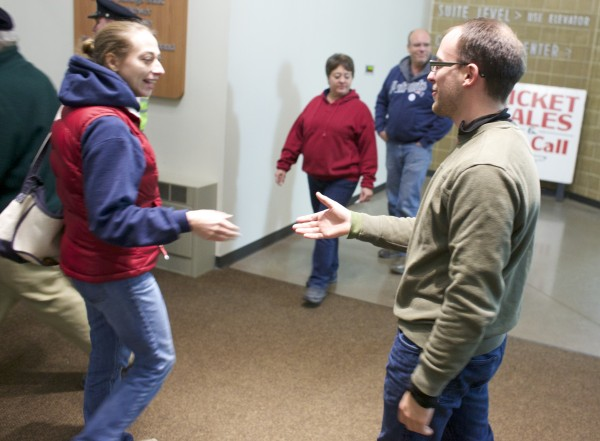 City council candidate Josh Plourde greets voters as they enter to cast their ballots at the Cross Insurance Center on Tuesday evening.