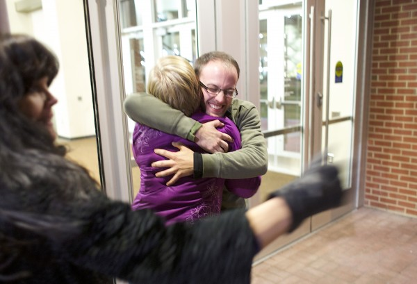 City council candidate Josh Plourde hugs Elizabeth Pelkey, left, while Plourde greeted voters entering to cast their ballots at the Cross Insurance Center Tuesday evening in Bangor.
