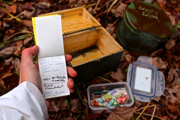 Crazy Camo, a traditional geocache in the Bangor City Forest, is upgraded from a wooden container to a metal container on Nov. 19, so the cache has a better chance of not being damaged by winter weather. While at the site, cache owner Aislinn Sarnacki checked the logbook, which is signed by all the geocachers who have found the Crazy Cache since it was hidden in September.