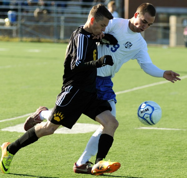 Maranacook's Kodey Solmitz tries to keep control of the ball from Madawaska's Alexander Nadeau in first-half action of the Class C boys state championship game at Hampden on Saturday.