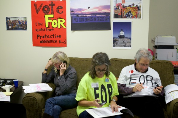 Volunteers (from left) Abby Huntoon, Nancy Wallerstein and John Rich make calls to residents in a last minute push for  votes for the waterfront protection ordinance at Protect South Portland headquarters in South Portland Tuesday night.