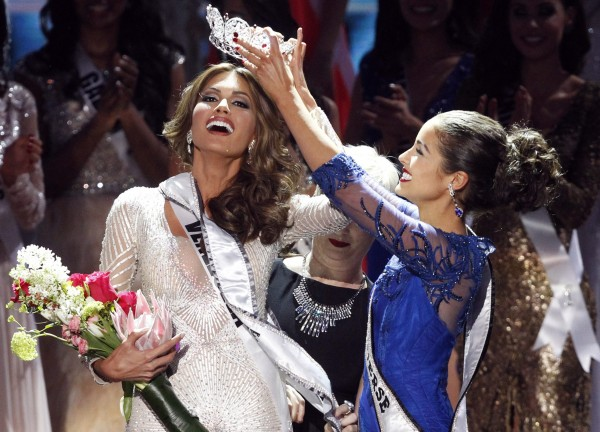 Miss Venezuela Gabriela Isler (left) reacts as she is crowned by Olivia Culpo, Miss Universe 2012, during the Miss Universe pageant at the Crocus City Hall in Moscow Nov. 9, 2013.