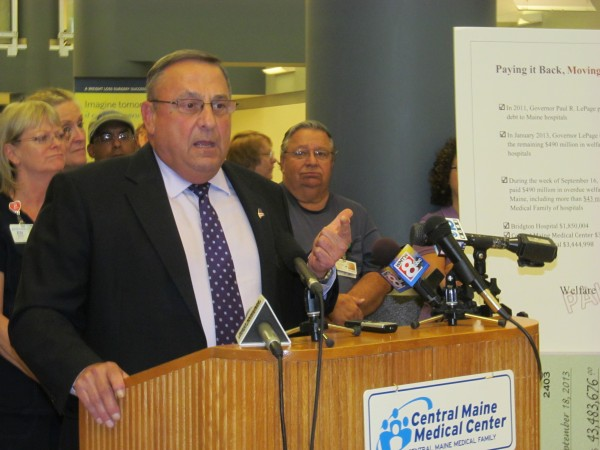 Gov. Paul LePage addresses a crowd of hospital employees and reporters at Central Maine Medical Center in Lewiston.
