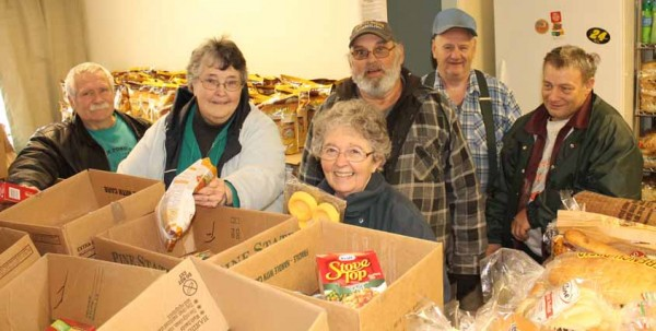 Volunteers at the Living Word Community Food Cupboard in Dover-Foxcroft prepare boxes for distribution. Pictured, from left, are Gary O'Brien, Barb O'Brien, Marilyn Mercer, Guy Raymond, John Leavitt and Terry McLain.