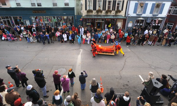 The College of the Atlantic's team Wheels on Fire compete in the sixth annual Bed Races in Bar Harbor Saturday morning. As the Early Bird Pajama Sale comes to a close, hundreds of people come from the shops around town to watch the event.