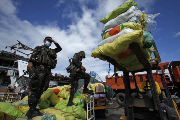 Filipino soldiers take part in a relief operation for victims of Typhoon Haiyan at Tacloban airport on Nov. 16, 2013.