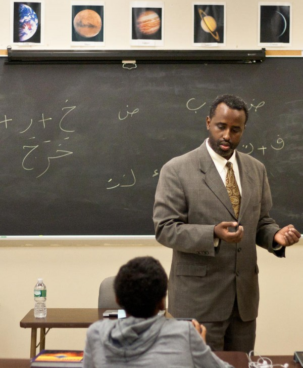Teacher Abdullahi Ahmed leads a vocabulary lesson in Arabic on Monday, Oct. 7, at Deering High School. The school is the first in Portland, and likely all of Maine, to offer Arabic as a foreign-language class.