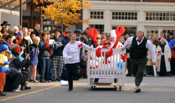 The Bar Harbor Inn's team Lazy Lobster races down Cottage Street during the sixth annual Bed Races in Bar Harbor Saturday morning. The team won the best decorated bed in the 10-team field this year.