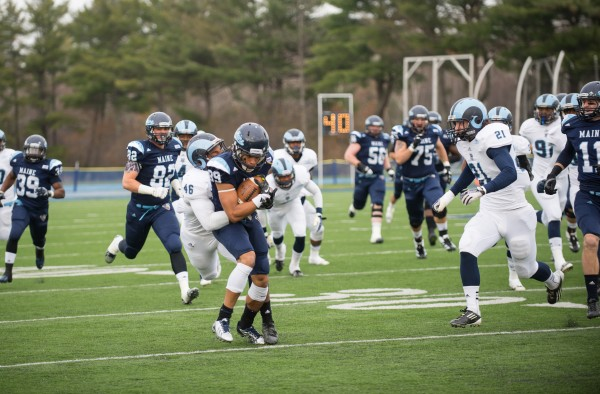 The University of Rhode Island's Adam Parker tries to take down University of Maine wide receiver Arthur Williams in Saturday afternoon's game held at Alfond Stadium in Orono. The Black Bears won 41-0.