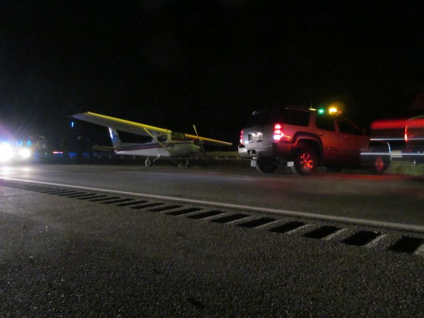This small airplane landed on Interstate 295 in Falmouth after experiencing engine troubles on the way from Waterville to the Portland International Jetport, police said Thursday night.