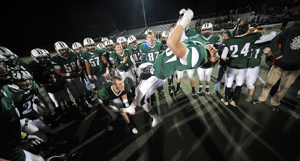 Jack Sylvester does a back flip after the Leavitt Hornets won 47-18 over Winslow in the Class C State Championship game Saturd