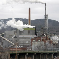 Rumford Paper's settlement of fraud allegations linked to parent company's bankruptcy