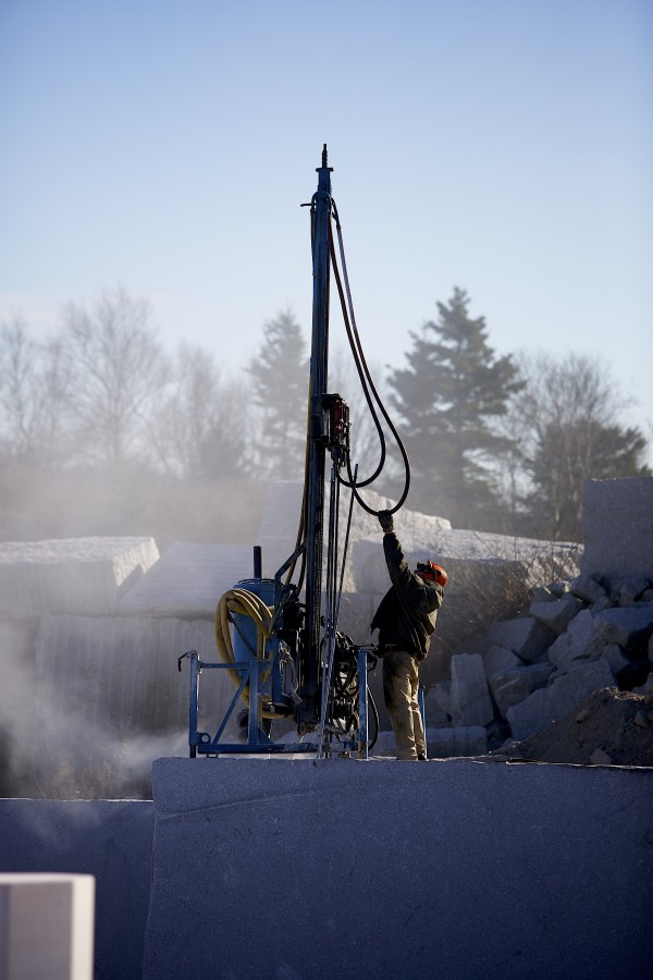 Chris Silva works at a quarry Thursday morning on Crotch Island in Maine. Deer Isle granite was used for the JFK Eternal Flame Memorial in Arlington, Va.