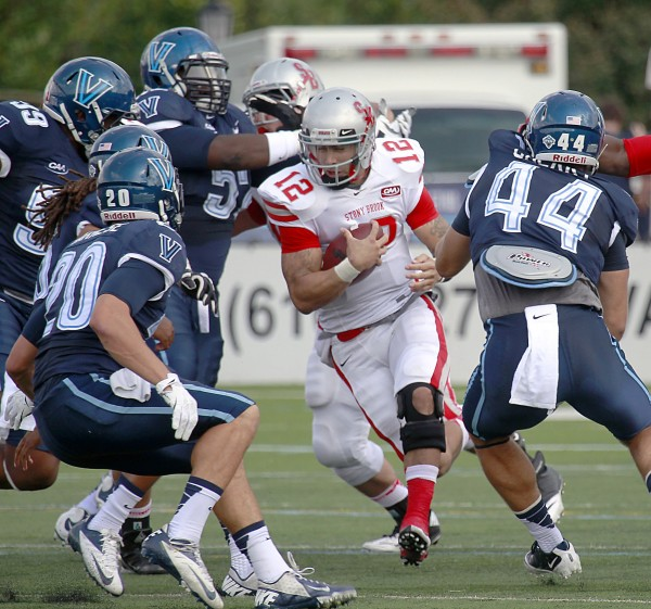 Stony Brook quarterback Lyle Negron is surrounded by Villanova defenders during the first quarter in Villanova, Pa., Saturday, September 21, 2013. Negron will lead Stony Brook against the Maine Black Bears at 12:30 p.m. Saturday in Orono.
