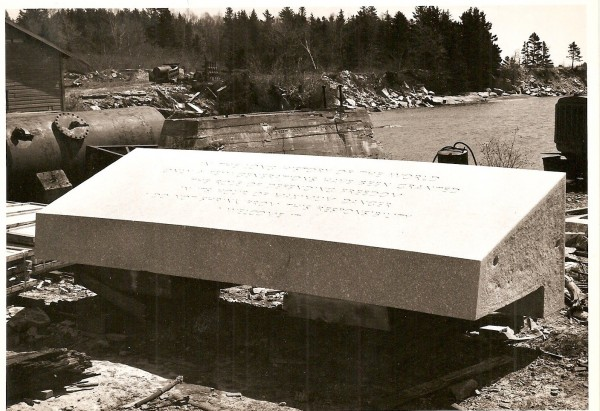 A granite stone sits at the quarry in Oceanville, on Deer Island, before it was shipped to Arlington where it would become part of John F. Kennedy memorial. A phrase from Kennedy's 1961 inaugural address was engraved on this stone. This photo is from the Deer Isle-Stonington Historical Society.