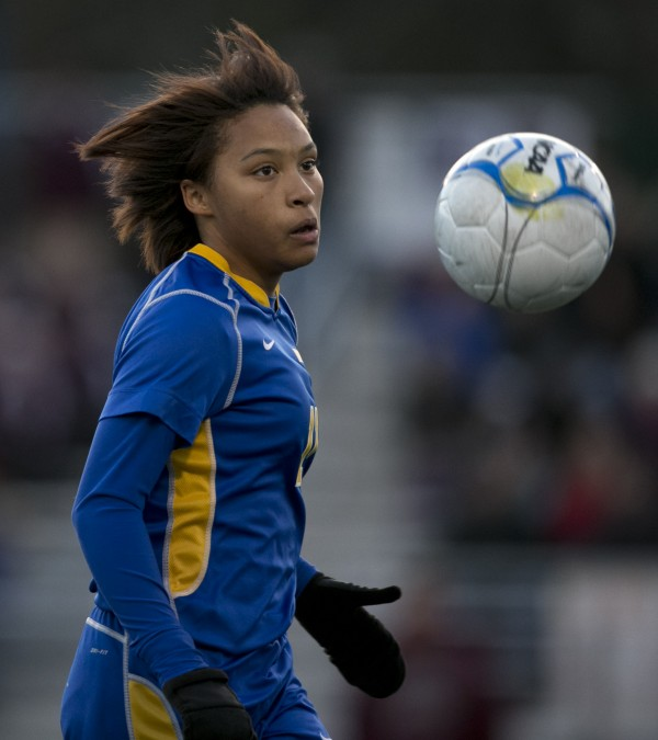 Washburn's Tyra Shaw pursues the ball in the first half against Richmond in the Class D soccer state championship, Saturday, Nov. 9, 2013, in Bath, Maine.