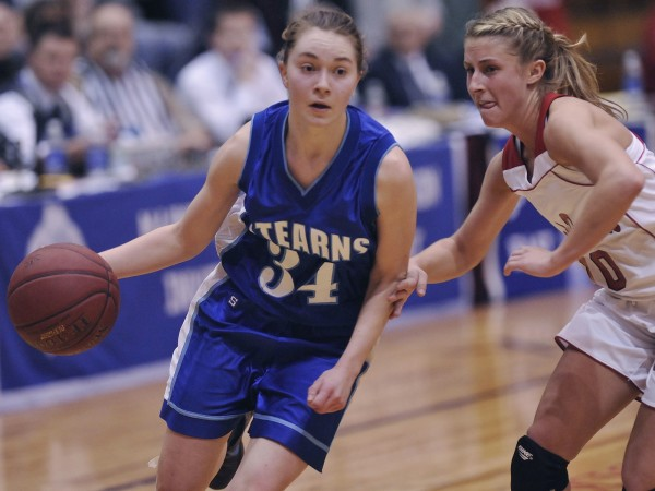 Former Stearns High School star Sigi Koizar, shown during a 2012 tournament game, helped lead the University of Maine women's basketball team to a 75-65 victory over Bryant on Saturday night in Bangor.