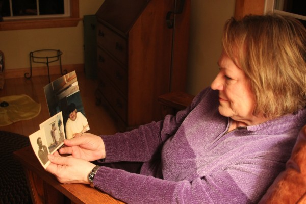 Annette Larrabee Jones looks at photos of her father, Keith Larrabee. He was one of the stone cutters who worked on the Kennedy memorial in Arlington in 1965.