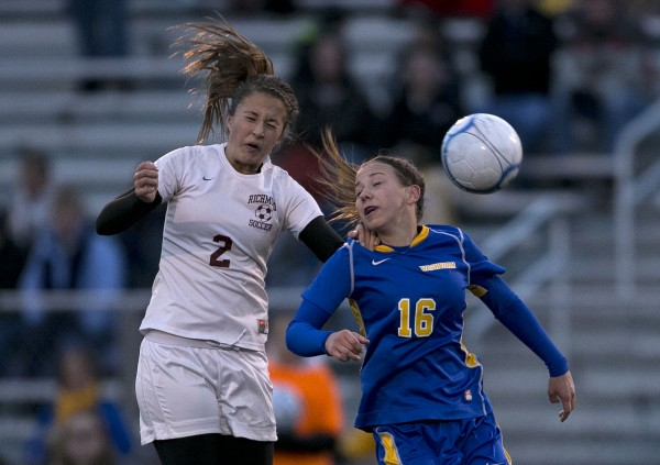 Richmond's Autumn Acord, left, and Washburn's Mikayla Churchill battle for the ball in the Class D soccer state championship, Saturday, Nov. 9, 2013, in Bath, Maine.