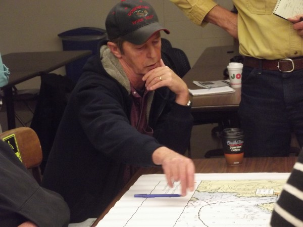 Machiasport harbormaster Wade Day refers to an area on a nautical chart during a meeting between Navy officials and fisherman at the University of Maine Machias Tuesday evening, Nov. 19. Navy officials updated fisherman on their plans to bury a power cable under Machias Bay.