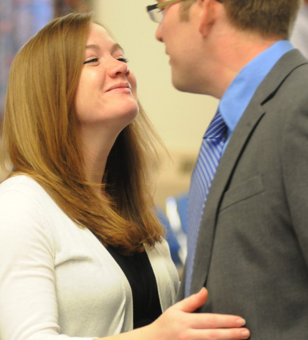 Malorie Sprague gives her husband, Ben, a kiss after he was appointed City Council chairman at Bangor City Hall on Wednesday.