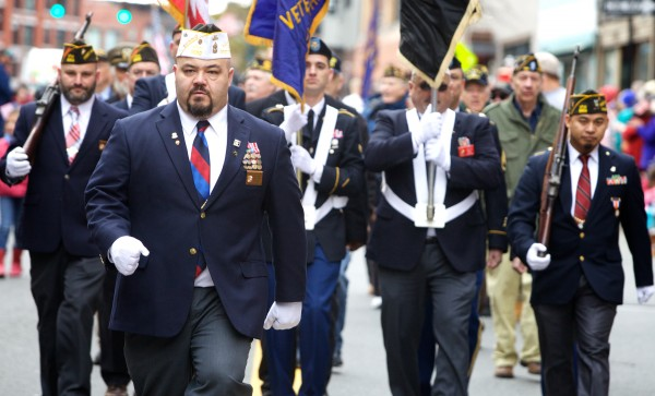 Cmdr. Steven San Pedro leads VFW Post 6859 down Congress Street Monday morning during Veterans Day observances in Portland.