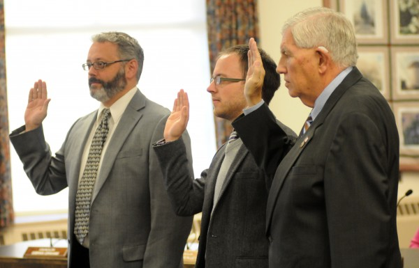 Newly elected city councilors Gibran Graham (from left) and Joshua Plourde along with re-elected councilor Nelson Durgin are sworn in at Bangor City Hall on Wednesday.
